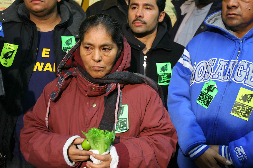 Maria Gonzalez and other workers at Republic Windows & Doors, 1333 N. Hickory Av. on Chicago's near north side, listen to Rev. Jesse Jackson speak during a press converence, Sunday, Dec. 7, 2008. The 250 workers are having a sit-in after all were laid off. (AP PHOTO/Eric Y. Exit)