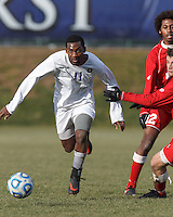 Amherst forward Robert Gooden (11) on the attack.  NCAA Division III Sectionals. In double-overtime, Amherst College (white) defeated St. Lawrence University (red), 2-1, on Hitchcock Field at Amherst College on November 23, 2013.