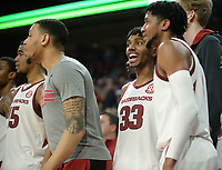 Arkansas guards Jimmy Whitt (33) and Isaiah Joe celebrate Wednesday, Jan. 15, 2020, during the second half against Vanderbilt in Bud Walton Arena. Check out nwaonline.com/photos for a gallery from the game. (NWA Democrat-Gazette/Andy Shupe)