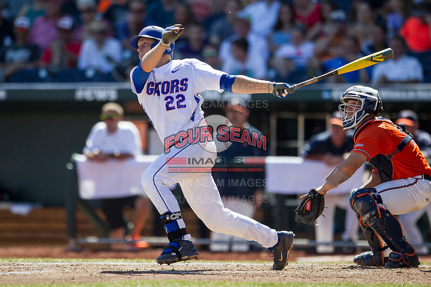 Florida Gators designated hitter JJ Schwarz (22) follows through on his swing against the Virginia Cavaliers in Game 11 of the NCAA College World Series on June 19, 2015 at TD Ameritrade Park in Omaha, Nebraska. The Gators defeated Virginia 10-5. (Andrew Woolley/Four Seam Images)