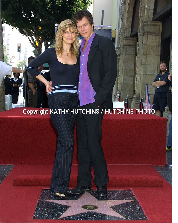 ©2003 KATHY HUTCHINS / HUTCHINS PHOTO.KEVIN BACON RECEIVES A STAR .ON THE HOLLYWOOD WALK  OF FAME.SEPTEMBER 30, 2003..KYRA SEDGWICK.KEVIN BACON