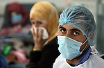 Palestinian doctor wears a protective masks as first cases of H1N1 flu infections have appeared, in Gaza City, 08 December 2009. According to the Health Ministery of the Hamas movement in Gaza, five people were infected by swine flu in Gaza City. Israel said Tuesday it is treating five suspected swine flu cases from Gaza in hopes of containing an outbreak of the virus in the blockaded Palestinian territory. Gaza health officials reported their first swine flu cases on Sunday. They say since then three people have died and nine others are hospitalized Photo by Wissam Nassar