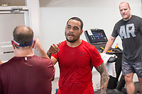 NWA Democrat-Gazette/BEN GOFF @NWABENGOFF<br /> Carl Lanje of Springdale congratulates his competitors after finishing Saturday, March 10, 2018, while competing in the 2018 Indoor Triathlon at the Jones Center in Springdale. Participants started in waves and had 10 minutes to swim, 20 minutes on a stationary bike and 15 minutes on a treadmill to log as many miles as possible.