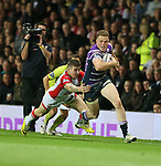Wigan Warriors Joe Burgess is tackled by St Helens Mark Percival- First Utility Super League Grand Final - St Helens v Wigan Warriors - Old Trafford Stadium - Manchester - England - 11th October 2014 - Pic Paul Currie/Sportimage
