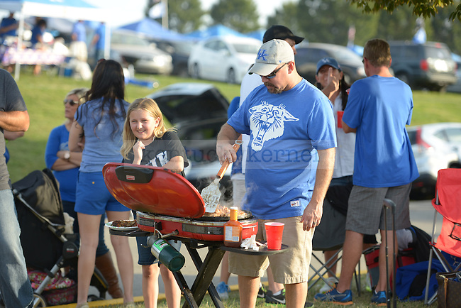 Steve Sexton grills for his friends and family outside of Commonwealth Stadium before the UK vs Florida game in Lexington, Ky., on Saturday, September 28, 2013. Photo by Eleanor Hasken | Staff