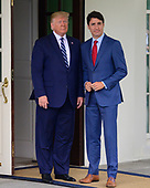 United States President Donald J. Trump participates in the arrival of Prime Minister Justin Trudeau of Canada at the Diplomatic Entrance of the White House in Washington, DC on Thursday, June 20, 2019.<br /> Credit: Ron Sachs / CNP