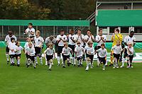 Deutsche Nationalmannschaft mit den Einlaufkindern