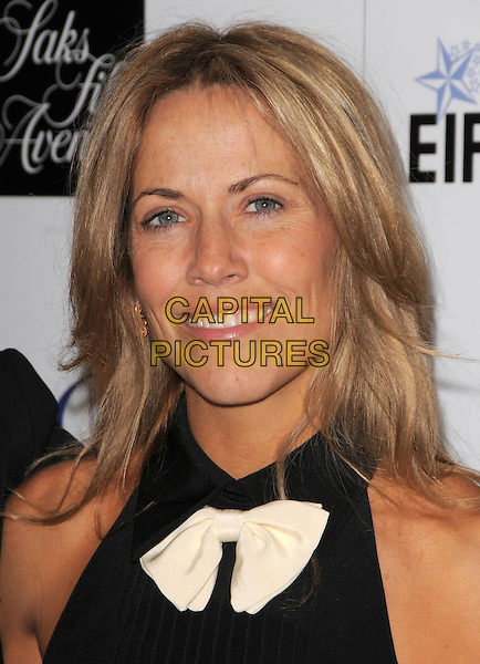 "SHERYL CROW.The Saks Fifth Avenue's ""Unforgettable Evening"" benefiting EIF's Women's Cancer Research Fund held at The Beverly Wilshire Hotel in Beverly Hills, California, USA..February 10th, 2009                                                                     headshot portrait black white bow tie.CAP/DVS.©Debbie VanStory/Capital Pictures."