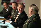United States President George W. Bush shares a laugh with, from left, West Virginia Governor Robert Wise, Colonel Bill Raney, President of the Army National Guard, Secretary of Defense Donald Rumsfeld, and Lieutenant Colonel Chester Carter of the Army National Guard during a visit to the West Virginia National Guard Headquarters in Charleston, West Virginia on February 14, 2001. President Bush visited several military bases last week to reaffirm his commitment to improve living conditions for the people who serve in America's armed forces. <br /> Credit: Paul Morse - The White House / CNP<br /> Mandatory Credit: Paul Morse / White House via CNP
