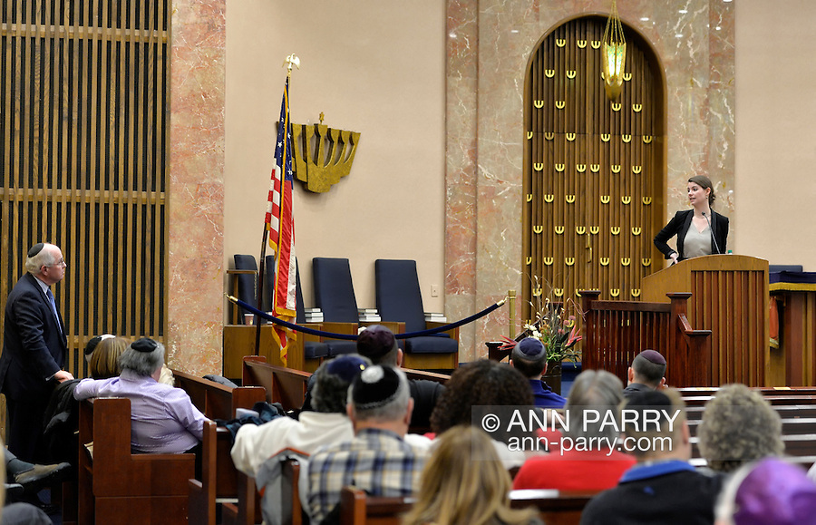 "Merrick, New York, USA. January 21, 2015. JANE BRADEN-GOLAY, from Schaffhausen, Switzerland, and President of the European Union of Jewish Students, is speaking from pulpit to Rabbi CHARLES A. KLEIN, at left, at the Merrick Jewish Centre the night before she is scheduled to address - upon the invitation of Ambassador Samantha Power, U.S. Permanent Representative to the United Nations - ambassadors and civil rights leaders at Rep. Power's residence, after the first United Nations General Assembly meeting on rise of anti-Semitic violence worldwide. When asked about recent terror attacks in France (against French satirical weekly newspaper Charlie Hebdo in Paris), Braden-Golay said, ""It's all still so very fresh.... Europe is in a shock state right now"" but that she hoped in weeks to come ""for all of us to take responsibility for creating a Europe that doesn't give room to this sort of terror again."" AJC Long Island and Merrick Jewish Centre presented the event ""Terrorism in France - Where Do We Go From Here?"" with speaker Braden-Golay, a senior at the University of Zurich."
