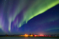 Aurora borealis swirls across the sky over interior Alaska, Truck parked at Gobler's Nob turnout on the Dalton Highway.