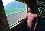 Maya Thapalyia looks out the window of her family's transitional house built in Majhitar, Nepal, by Dan Church Aid, a member of the ACT Alliance. Her family's home collapsed in an April 2015 earthquake that ravaged Nepal.