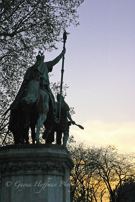 Statue of Charlemagne on horseback in front of Notre Dame, Paris, France, evening sunset.