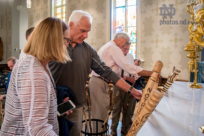 August 25, 2017; ND Trail day 12: Core pilgrims receive commemorative walking sticks following Mass in the Basilica of the Sacred Heart. (Photo by Matt Cashore/University of Notre Dame)