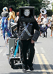 Kryton from Red Dwarf pulls a cartload of electronics during the 25th  Annual Fremont Summer Solstice Parade in Seattle on June 22, 2013. UPI Photo/Jim BryantPainted nude bicyclists  ride during the 25th  Annual Fremont Summer Solstice Parade in Seattle on June 22, 2013.     ©2013.  Jim Bryant.  ALL RIGHTS RESERVED.