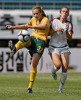 USWNT midfielder (9) Heather O'Reilly has the ball cleared away from her  by Australia's (32) Ellyse Perry during the Peace Queen Cup  in Suwon, South Korea.  The U.S. defeated Australia, 2-1, at the Suwon Sports Complex.