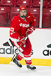 Wisconsin Badgers Gavin Hartzog (13) skates during warmups before an NCAA hockey game against the Alabama Huntsville Chargers at the Kohl Center in Madison, Wisconsin on October 15, 2010. The Badgers won 7-0. (Photo by David Stluka)