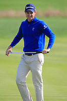 Justin Rose (ENG) sinks his putt on the 8th green during Sunday's Final Round of the 2014 BMW Masters held at Lake Malaren, Shanghai, China. 2nd November 2014.<br /> Picture: Eoin Clarke www.golffile.ie