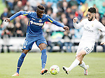 Getafe's Karim Yoda (l) and Real Madrid's Isco Alarcon during La Liga match. April 16,2016. (ALTERPHOTOS/Acero)