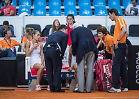 Bratislava, Slovenia, April 23, 2017,  FedCup: Slovakia-Netherlands, Dubbles, Burger NED) gets sick during the match and gets doctors attention.<br /> Photo: Tennisimages/Henk Koster