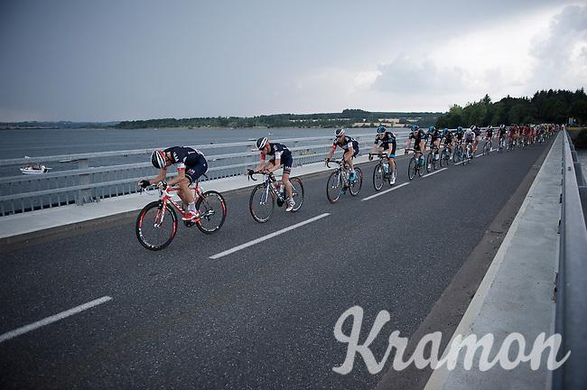 peloton led by Team IAM over the bridge of the Lac de Pareloup<br /> <br /> stage 14: Rodez - Mende (178km)<br /> 2015 Tour de France