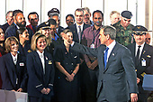 United States President George W. Bush waves farewell to employees after signing the Aviation security bill at Ronald Reagan Washington National Airport in Washington, DC on November 19, 2001.  <br /> Credit: Ron Sachs / CNP