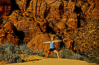 Woman doing yoga, Snow Canyon State Park, Utah, USA