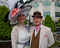 LOUISVILLE, KY - MAY 06: A man and women pose for a photo while dressed to the nines on Kentucky Derby Day at Churchill Downs on May 6, 2017 in Louisville, Kentucky. (Photo by Jesse Caris/Eclipse Sportswire/Getty Images)