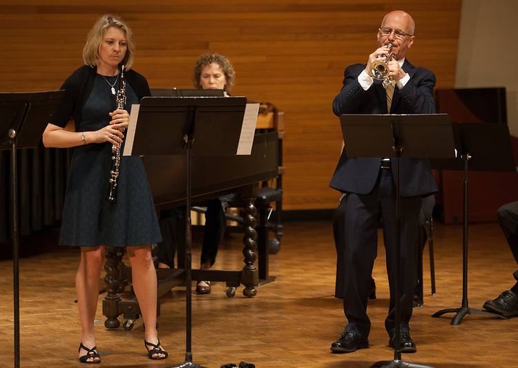 Michele Fiala, Associate Professor of Oboe, and John Schlabach, Professor of Trumpet, perform with an ensemble of faculty and alumni in Glidden Hall during the Faculty and Alumni Centennial Chamber Music Recital on Friday, April 21, 2017. © Ohio University / Photo by Kaitlin Owens