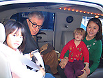 *** EXCLUSIVE Coverage ***.Woody Allen with his wife Soon-Yi Previn and daughters Bechet and Manzie Allen arriving in Lisbon, Portugal..( picyured in their stretch limo car ).Debember 30, 2004.© Walter McBride /