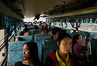 Near Savannakhet, Laos, August 21, 2007.Local bus is the only means of transportation for most Lao people; it slow and full of surprises...