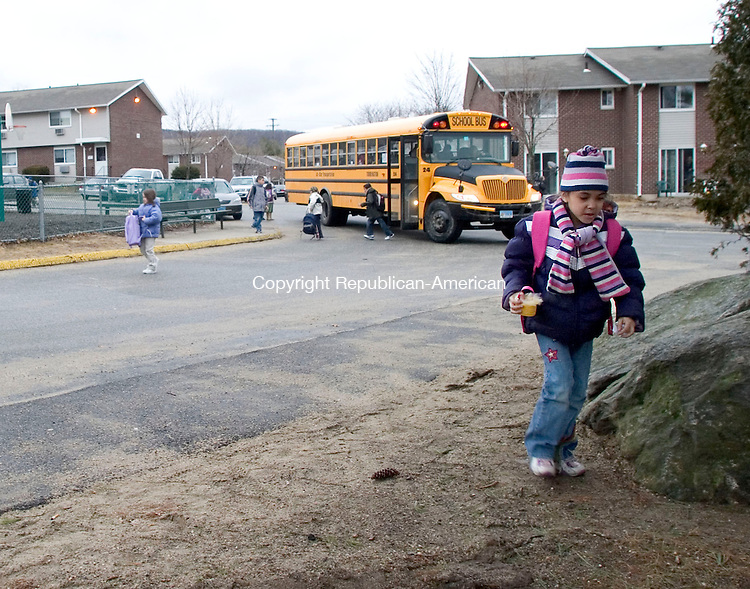 TORRINGTON, CT- 15 MARCH 07- 031507JT05- <br /> Makayla DeLaCruz, 7, comes home from school at Northside Terraces, a federally subsidized housing project in Torrington which recently earned a national quality award.<br /> Josalee Thrift Republican-American