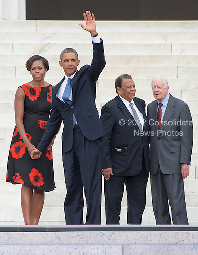 United States President Barack Obama waves to the crowd as he prepares to depart with first lady Michelle Obama following the Let Freedom Ring ceremony on the steps of the Lincoln Memorial to commemorate the 50th Anniversary of the March on Washington for Jobs and Freedom.  Ambassador Andrew Young and former U.S. President Jimmy Carter share a conversation at right.<br /> Credit: Ron Sachs / CNP