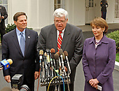 Bipartisan United States House of Representatives Leaders speak to reporters after their meeting with US President George W. Bush in the Oval Office of the White House in Washington, DC on March 21, 2003.  Left to right: US House Majority Whip Tom DeLay (Republican of Texas); Speaker of the US House Dennis Hastert (Republican of Illinois); and US House Minority Leader Nancy Pelosi (Democrat of California).<br /> Credit: Ron Sachs / CNP