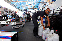 Apr 25, 2014; Baytown, TX, USA; NHRA top fuel dragster driver Antron Brown mixes fuel in the pits during qualifying for the Spring Nationals at Royal Purple Raceway. Mandatory Credit: Mark J. Rebilas-USA TODAY Sports