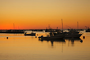 Sunrise from over boats at Rye Harbor in Rye, New Hampshire during the autumn months.