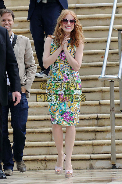 Jessica Chastain.'Madagascar 3' Stars during Cannes Film Festival, Cannes, France, .May 18th 2012..full length green pink floral print dress sunglasses retro hands smiling sleeveless shift .CAP/CAS.©Bob Cass/Capital Pictures.