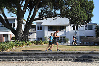 1st April 2020, Kohi Beach, Auckland, New Zealand;  Running in the warm weather at Kohi Beach during the lockdown due to Covid-19. Kohimarama, Auckland, New Zealand on Wednesday 1 April 2020.