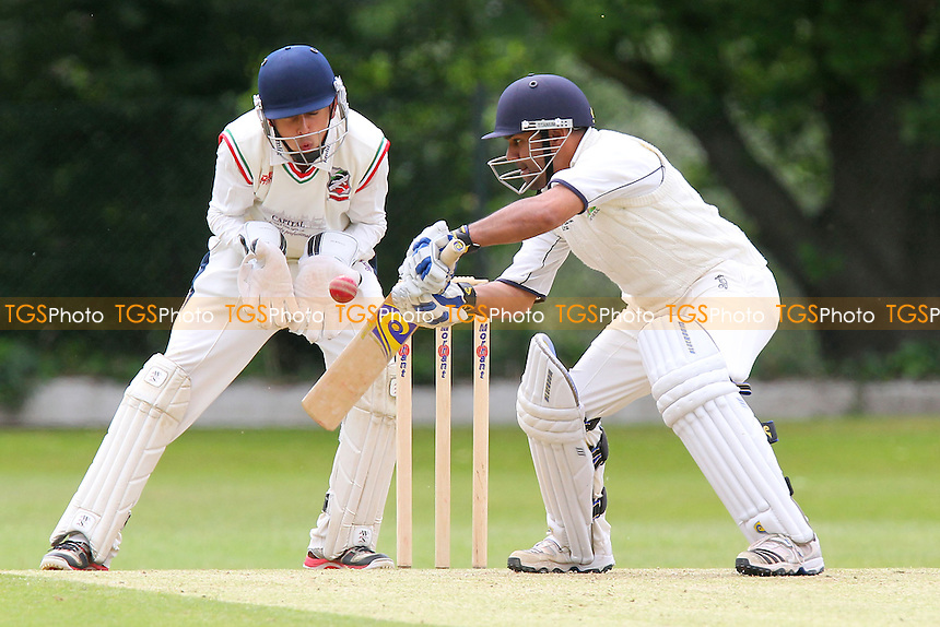 Arfan Akram in batting action for Wanstead - Wanstead CC vs Ilford CC - Essex Cricket League at Overton Drive - 15/06/13 - MANDATORY CREDIT: Gavin Ellis/TGSPHOTO - Self billing applies where appropriate - 0845 094 6026 - contact@tgsphoto.co.uk - NO UNPAID USE