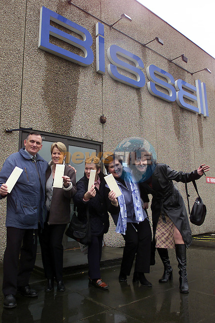 Noel Mohan, Ann Monahan, Ann Rice,Amanda Mooney Breda Heeney with there clocking out cards after they walked throught the door for the last time as the factory closed its doors at noon today.Pic Fran Caffrey Newsfile.©Newsfile Ltd.