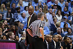 CHAPEL HILL, NC - DECEMBER 30: Wake Forest head coach Danny Manning talks to referee Ron Groover. The University of North Carolina Tar Heels hosted the Wake Forest University Demon Deacons on December 30, 2017 at Dean E. Smith Center in Chapel Hill, NC in a Division I men's college basketball game. UNC won the game 73-69.