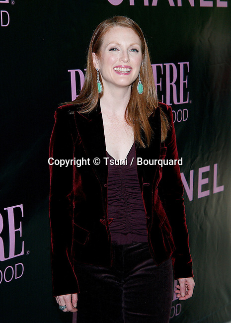 Julianne Moore arriving at the 9th Annual Premiere Women in Hollywood Luncheon at the Four Seasons Hotel in Los Angeles. October 16, 2002.           -            MooreJulianne243.jpg