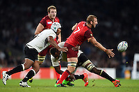 Chris Robshaw of England offloads the ball after being tackled. Rugby World Cup Pool A match between England and Fiji on September 18, 2015 at Twickenham Stadium in London, England. Photo by: Patrick Khachfe / Onside Images