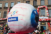 Düsseldorf, Germany. 16 February 2015. A float depicts survellance by Google and Facebook. The traditional Shrove Monday (Rosenmontag) carnival parade takes place in Düsseldorf, Germany. 1.2 million revellers lined the route. The Monday parades went ahead despite increased terror warnings which led to the parade in Brunswick (Braunschweig) being cancelled shortly before it was due to take place.