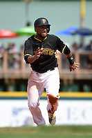 Pittsburgh Pirates catcher Elias Diaz (66) during a Spring Training game against the Boston Red Sox on March 12, 2015 at McKechnie Field in Bradenton, Florida.  Boston defeated Pittsburgh 5-1.  (Mike Janes/Four Seam Images)
