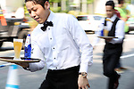 """May 22, 2016, Tokyo, Japan - Waiters carry glasses of beer on the trays during the """"garcon carry race"""" in Tokyo on Sunday, May 22, 2016 as a  part of """"Aperitif 365"""" event. 46 contestants from restaurants and cafes participated the beer carry race vying for the first prize of 300,000 yen, sponsored by French beer Kronenbourg.  (Photo by Yoshio Tsunoda/AFLO) LWX -ytd-"""