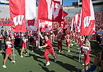 Wisconsin Badgers cheerleaders lead the football team onto the field prior to an NCAA Big Ten Conference football game against the Maryland Terrapins Saturday, October 21, 2017, in Madison, Wis. The Badgers won 38-13. (Photo by David Stluka)