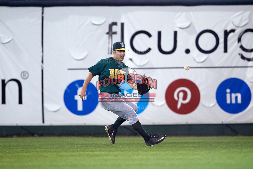 Siena Saints left fielder Ryne Martinez (9) fields a hit during a game against the Stetson Hatters on February 23, 2016 at Melching Field at Conrad Park in DeLand, Florida.  Stetson defeated Siena 5-3.  (Mike Janes/Four Seam Images)