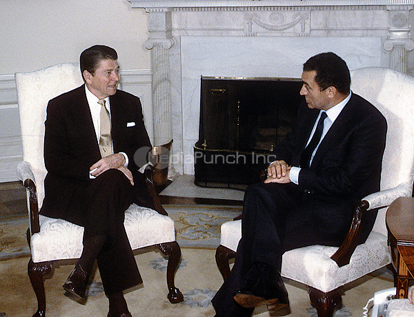Washington DC., USA, February 14, 1984<br /> President Ronald Reagan meets with Egyptian President Hosni Mubarak in the Oval Office of the White House. Credit: Mark Reinstein/MediaPunch