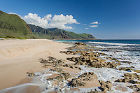 The Wai'anae Mountains embrace the rocky shoreline of Yokohama Bay, West O'ahu.
